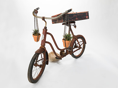 Bike planter furniture as art auction item for KDUR